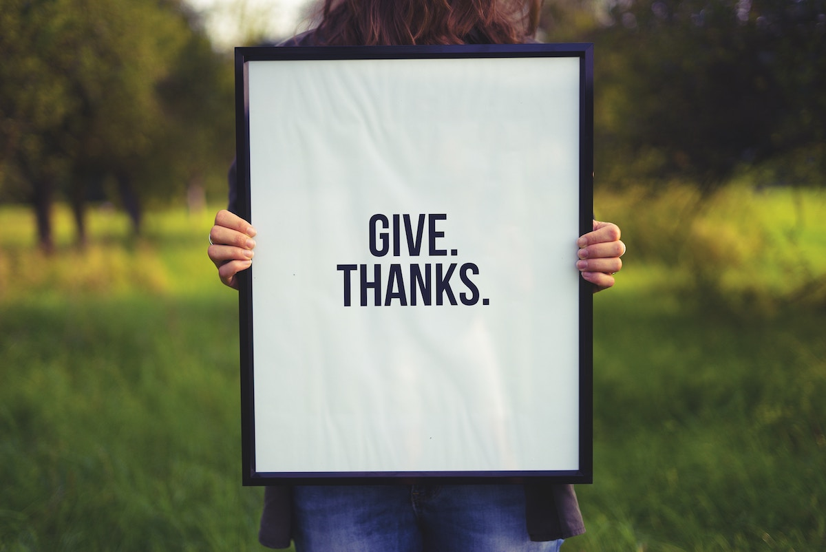 A black on white poster saying Give Thanks